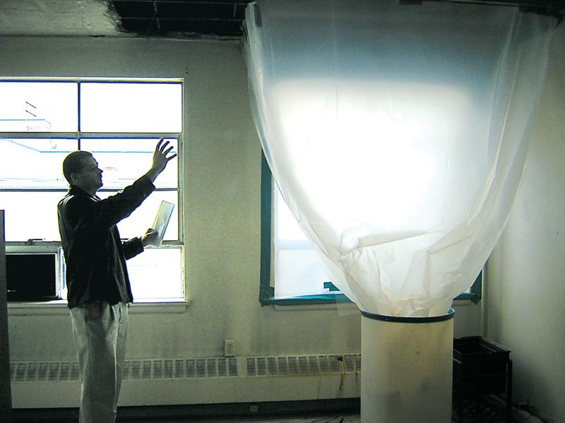 by: OUTLOOK FILE PHOTO - Mold and structural deficiencies at the Hansen Building in outer Northeast Portland are two of the reasons the Multnomah County Sheriffs Office is looking for a new building in East County. In this photo from 2006, Detective Todd Shanks explains how rain leaking through the roof has damaged the ceiling.