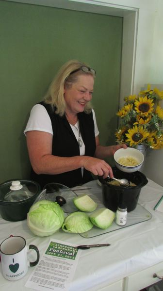 Photo Credit: SPOTLIGHT PHOTO: DARRYL SWAN - Sauerkraut Festival organizer Lisa Smith demonstrates the ease and simplicity of making small batches of sauerkraut at home.