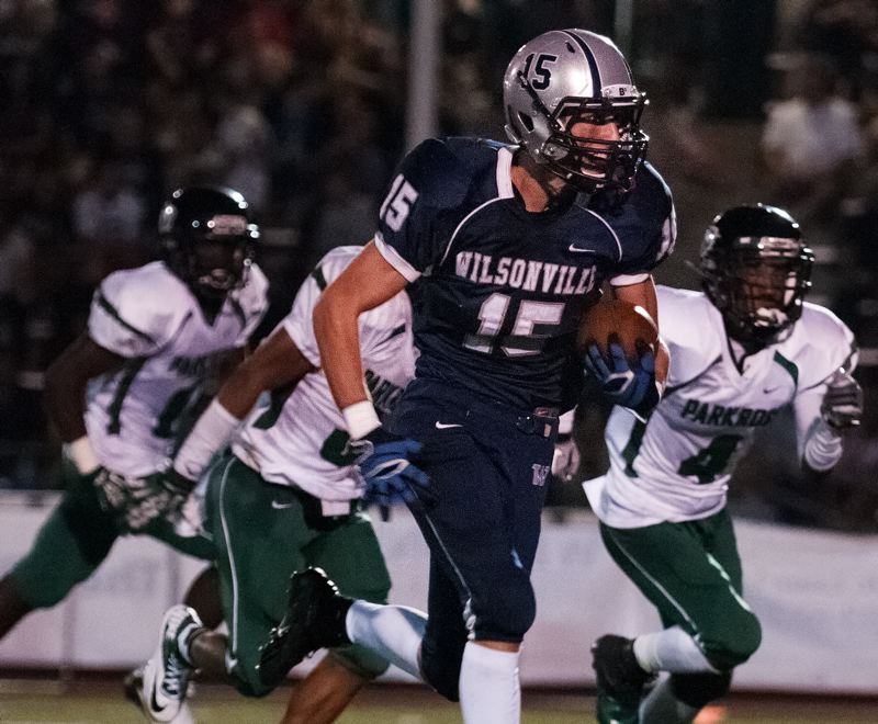 by: SPOKESMAN PHOTO: JOSH KULLA - Derek Sunkle rushed for 250 yards and three touchdowns in Wilsonville's 42-6 win Friday night over Parkrose.