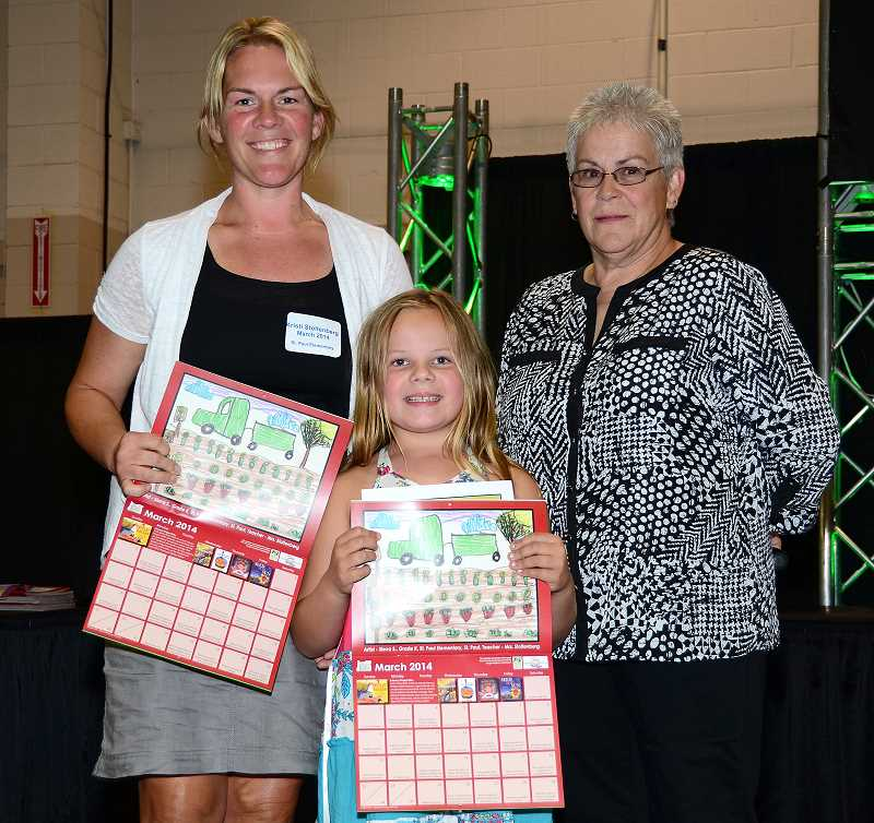by: SUBMITTED - Sierra Stoltenberg, a first-grader at St. Paul Elementary School, stands with her mom and kindergarten teacher Kristi Stoltenberg (left) and Cindy Ettestad, the Oregon Ag in the Classroom Foundation board vice president. Sierras artwork is featured on the foundations 2014 calendar.