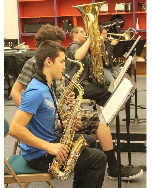 by: LINDSAY KEEFER - Kennedy High School's band practices during class earlier this month. The band, which was eliminated from last year's budget, is one of the programs restored this year.