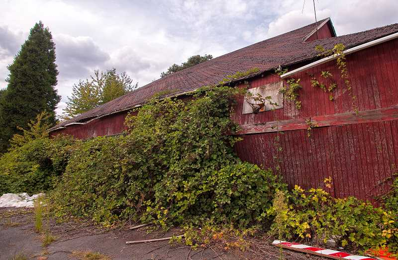 by: JOSH KULLA - The bowing of this exterior wall shows how close the red barn is to collapsing.