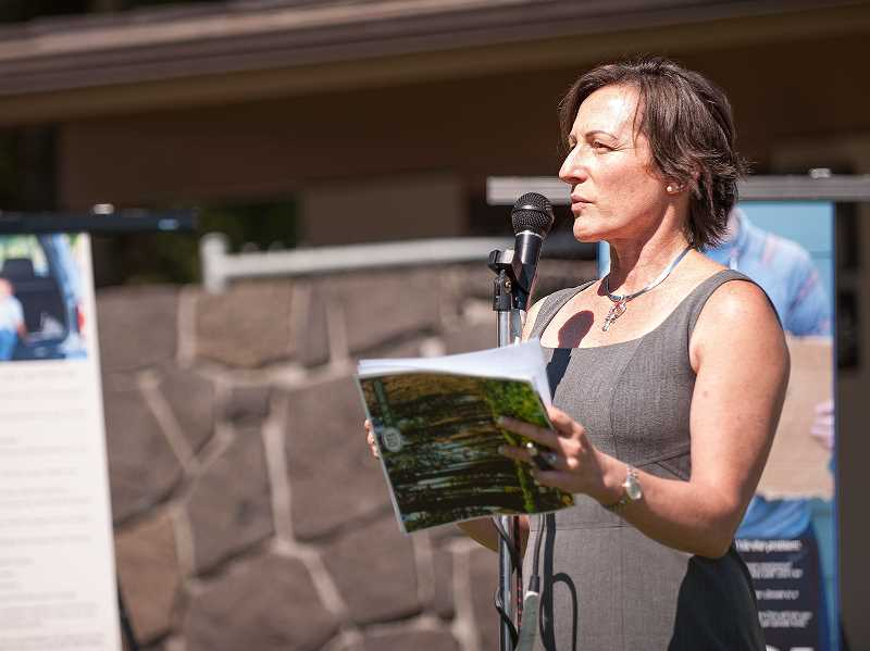 by: JOSH KULLA - Oregon Travel Information Council Chairwoman Gwenn Baldwin speaks at last week's ceremony at the newsly named French Prairie Rest Area.