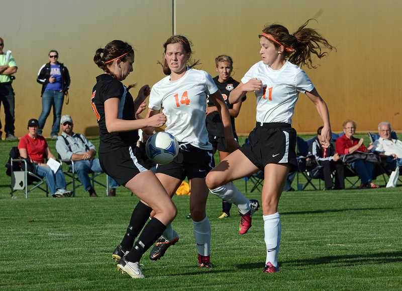 by: JOHN WILLIAM HOWARD - Scappoose juniors Elanor Jones and Lauren Frank fight for possession in the first half of the Tribe's 2-1 victory over Molalla. Both Jones and Frank scored a goal in the victory on Tuesday, Sept. 17 at home.