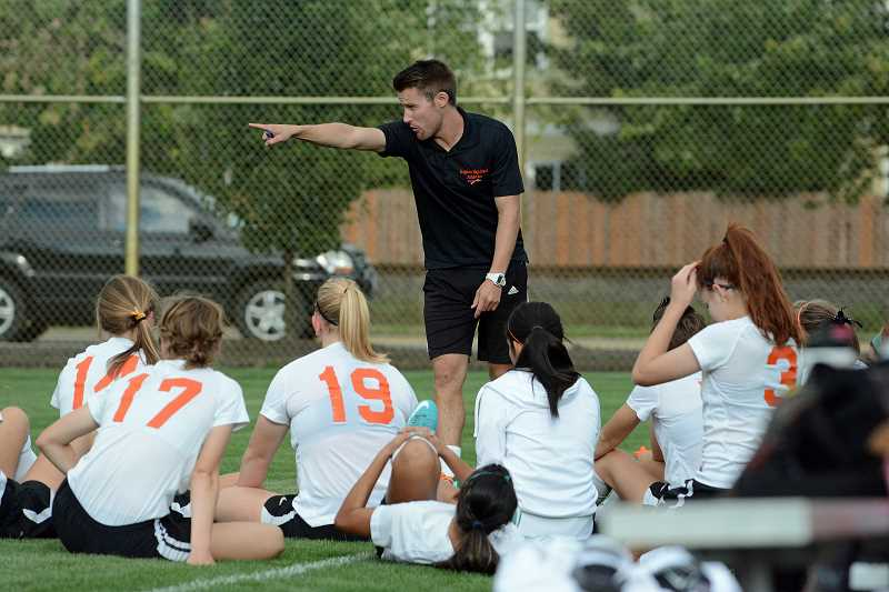by: JOHN WILLIAM HOWARD - Coach Nicholas Heffernan makes adjustments during halftime of Scappoose's 2-1 victory over Molalla. The win, which is Heffernan's first at Scappoose, came thanks to a goal in each half on Tuesday, Sept. 12.