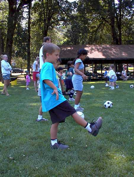 by: SUBMITTED PHOTO - Soccer is fun for all ages. Get the kids started playing now.