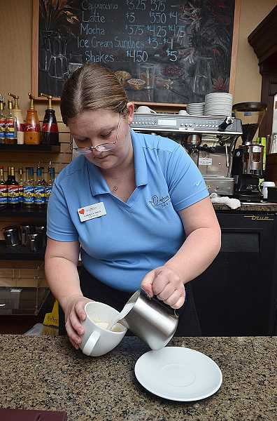 by: REVIEW PHOTO: VERN UYETAKE - Bubbly barrista Carolyn Nolin serves up joy along with coffee at The Overlook. The community is invited to come in and give the new establishment a try.
