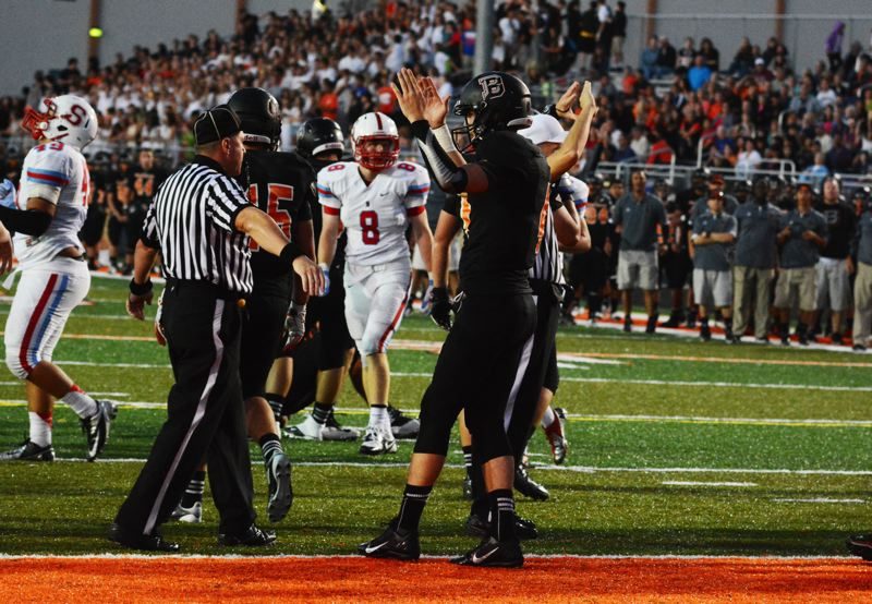 by: TIMES PHOTO: MATT SINGLEDECKER - Beaverton quarterback Sam Noyer pleads his case to an official that he scored a touchdown on 4 and 1 from the South Salem 1 in the second quarter.