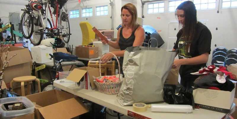 by: SUBMITTED PHOTO - Michele Beyer and her daughter, Leah, sort through some of the donations they have received for the upcoming WLHS grad night rummage sale fundraiser.