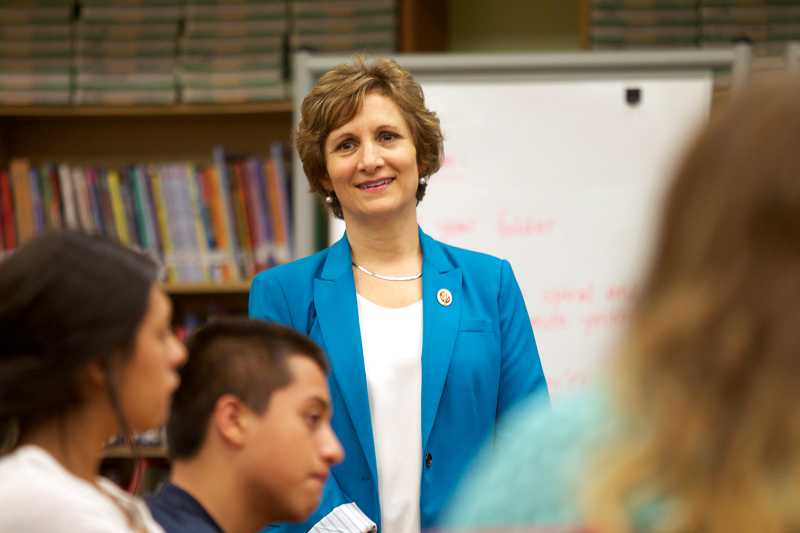 by: TIMES PHOTO: JAIME VALDEZ - Congresswoman Suzanne Bonamici talks with students at Highland Park Middle School during Friday's visit.