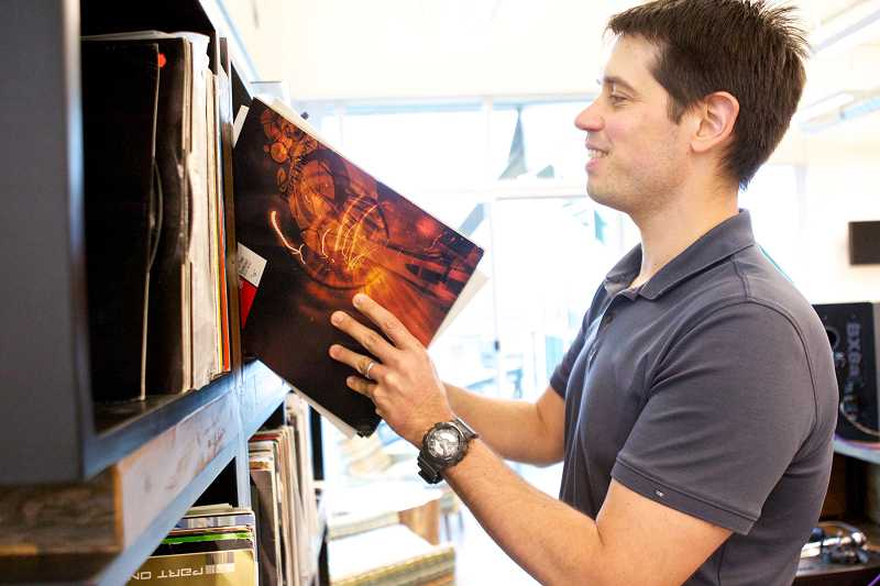 by: TIMES PHOTO: JAIME VALDEZ - Discogs CEO Kevin Lewandowski goes through a collection of vinyl records that his employees play during business hours.
