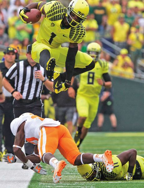 by: TRIBUNE PHOTO: JAIME VALDEZ - Oregon Ducks receiver Josh Huff hurdles a Tennessee defender in the 59-14 win last week at Autzen Stadium.