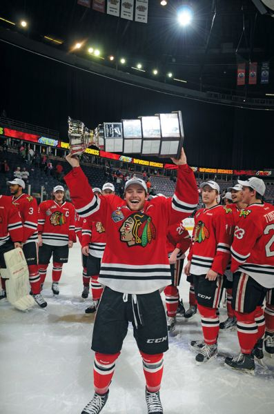 by: COURTESY OF ANDY DEVLIN/EDMONTON OIL KINGS - Winterhawks forward Chase De Leo hoists the Ed Chynoweth Cup after Portlands Western Hockey League title victory last season.