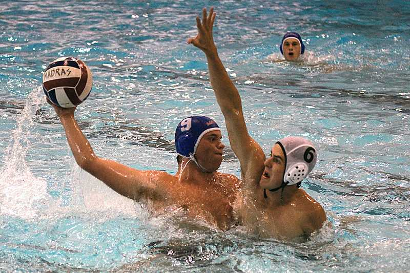 by: BILLY GATES/THE PIONEER - Madras water polo player Brady Tucker winds up for a shot against a Summit defender in the White Buffalos' 11-7 loss to the Storm on Thursday at the Madras Aquatic Center.