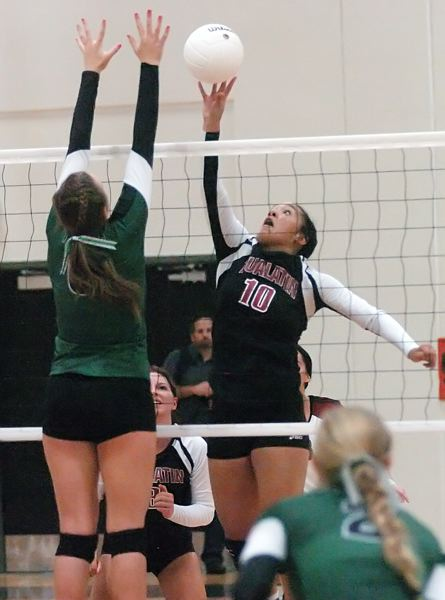 by: DAN BROOD - UP HIGH -- Tualatin senior Jasmine Miller (10) looks to get the ball over the hands of Tigard senior Michelle Simmons in last Thursday's match.