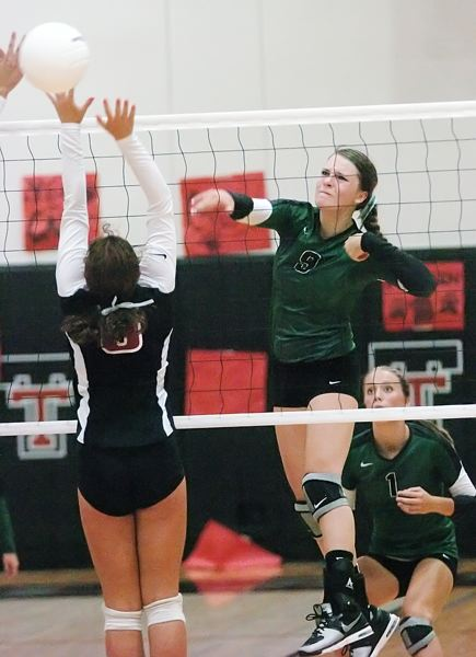 by: DAN BROOD - SMACK -- Tigard sophomore Cassie Erickson hits ball hard over the net during last week's match.