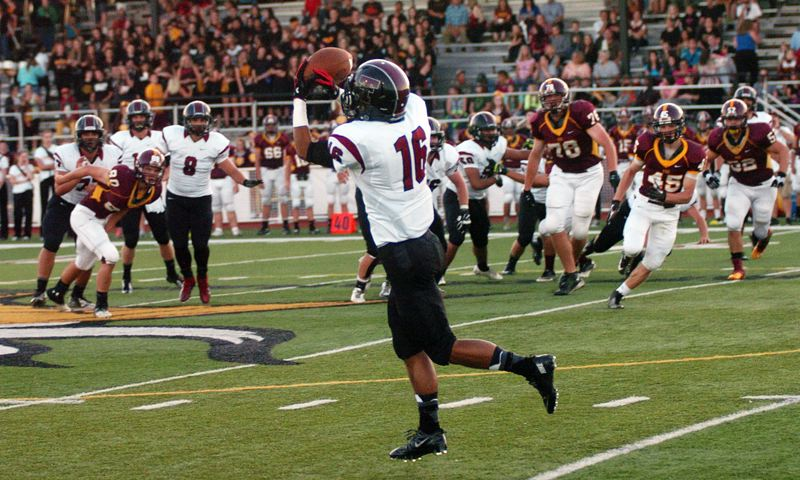 by: DAN BROOD - GOOD CATCH -- Tualatin senior receiver Nick Hines (16) makes a grab during the first quarter of Friday's game at Forest Grove.