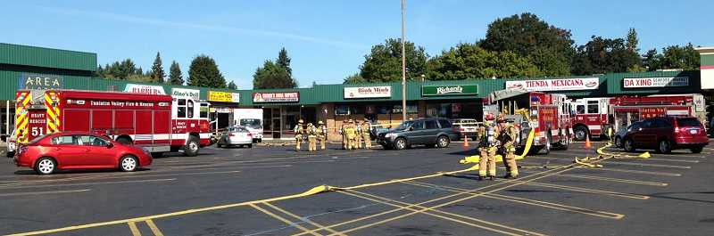 Crews evacuated a strip mall at Pacific Highway and Hall Boulevard after a contractor ruptured a gas line in one of the stores.