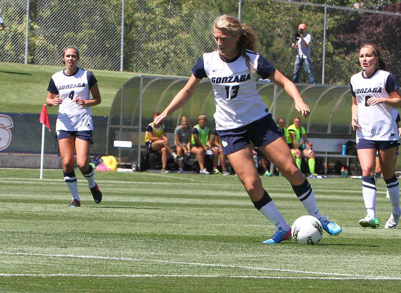 by: GU ATHLETICS / TORREY VAIL - Canby High alumna Karley Baggerly (13) scored the first goal of her collegiate career Sept. 17 as the Gonzaga women's soccer team defeated Eastern Washington.
