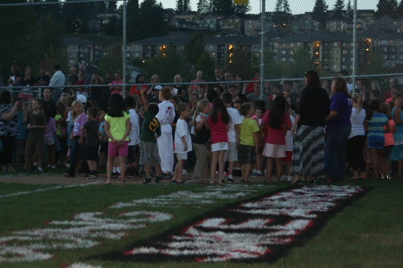 by: PHOTO BY: CINDY FREE-FETTY - After many hours of hard work and the dedication of volunteers, Oregon Trail Elementary students and the community come out celebrate the ribbon-cutting event of their new Field of Dreams on Thursday, Sept. 19.