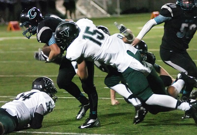 by: DAN BROOD - TIGER TACKLE -- Tigard senior defensive end Nick Duron (15) brings down Century's Christian Gutierrez-Treat.