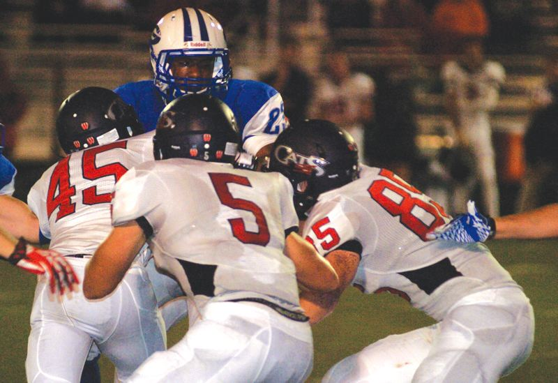 by: THE OUTLOOK: DAVID BALL - Gresham running back Sirgio Hoffman is met by a crowd of Westview tacklers.