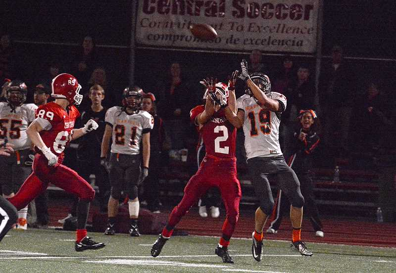 by: JOHN WILLIAM HOWARD - Senior receiver Justice Oman (19) jumps for a catch late in the second half of the Indian's 22-14 loss to Central on Friday night. Oman led the Tribe with 12 catches for 165 yards, including this reception during their final scoring drive in the fourth quarter.