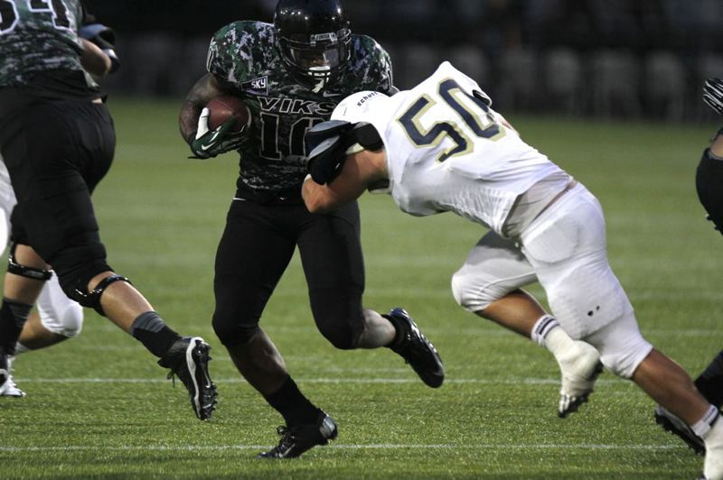by: TRIBUNE PHOTO: JONATHAN HOUSE - Portland State running back DJ Adams, taking on an Eastern Oregon defender in the season opener, leads all Big Sky runners in rushing yardage per game as the Vikings prepare for their 2013 conference debut Thursday night at home against Cal Poly.