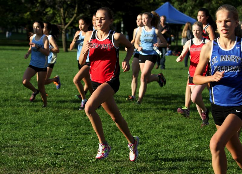 by: JON HOUSE - Clackamas freshman Maia Edwards held her own with the top runners from Class 6A power St. Marys and the top runners from Lakeridge in a Sept. 18 cross country meet at Lents Park.