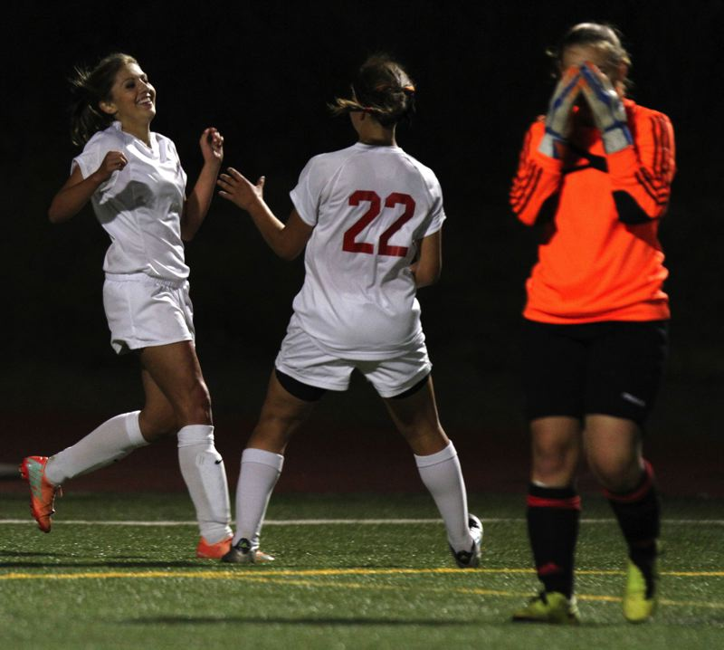 by: JON HOUSE - Freshman Maddy Griffith (left) and senior Sitera Allison (22) celebrate a goal in last weeks game with Canby. Griffith scored both of Oregon Citys goals in a 2-2 tie.