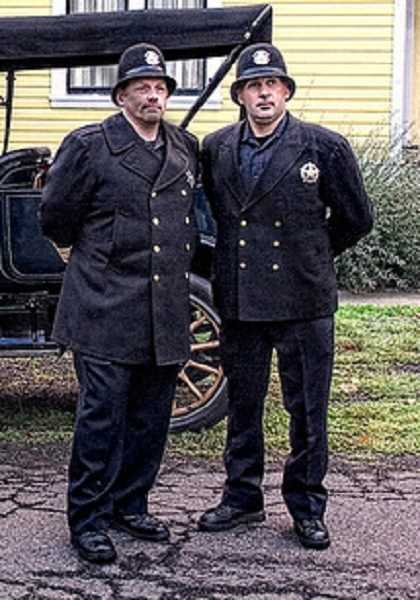 by: GLEN BLEDSOE - Officers Mike Francis and Brad Moyle dressed in 1913 style garb for the Living History Tour, but a DUII case forced them back into the present.