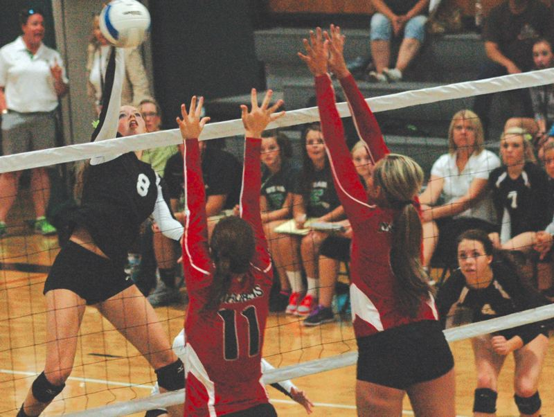 by: ESTACADA NEWS: PARKER LEE - Estacadas Tori Johnson sends a kill over the net during Thursdays 3-0 loss to Madras.