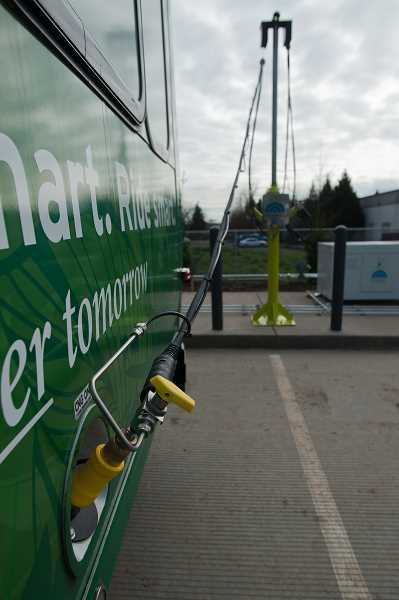 by: JOSH KULLA - One of SMARTs compressed natural gas-powered cutaway buses fuels up at the agencys CNG fueling station.