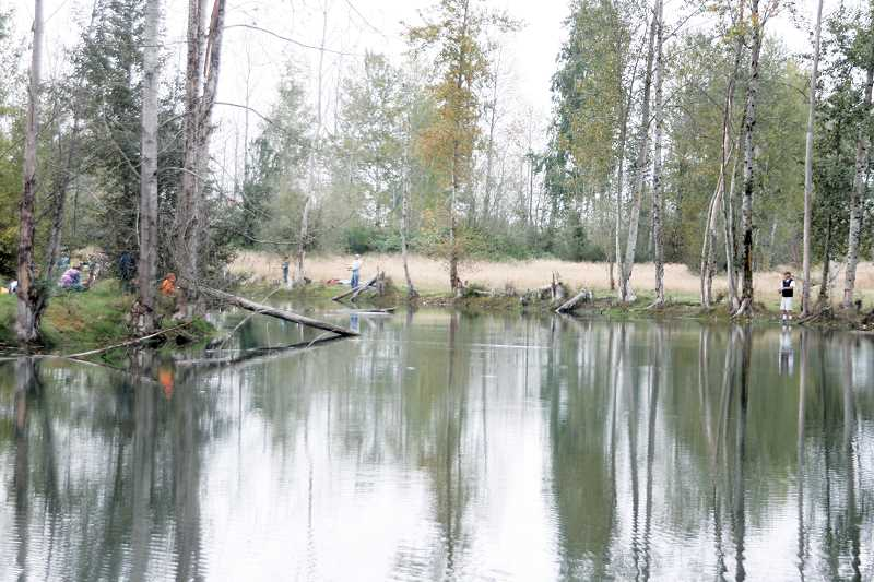 by: PHIL HAWKINS - Anglers lined the edge of the sixth pond at St. Louis Ponds Saturday to catch rainbow trout that was stocked before the event.