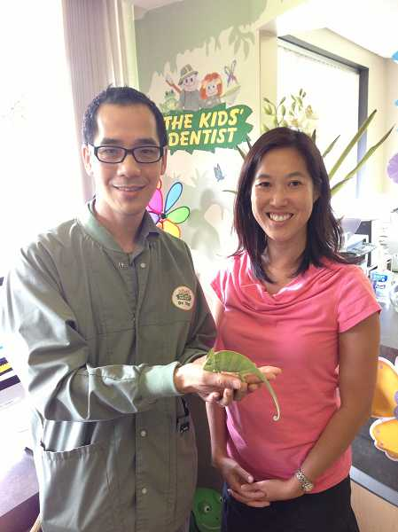by: SUBMITTED PHOTO: CITY OF WEST LINN - Dr. Dana Anthony Yip - with chameleon Yoda - visits with City Councilor Jenni Tan.