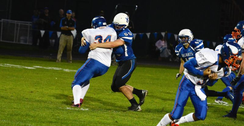 by: TIMES PHOTO: MATT SINGLEDECKER - Valley Catholic defensive lineman Drew VanderZanden and the Valiant defense had little trouble shutting out Umatilla, 56-0 on Friday.