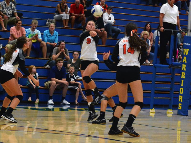 by: TIMES PHOTO: MATT SINGLEDECKER - Beavertons Kenzie Hargens digs out a serve on the Beavers side of the floor against Aloha.
