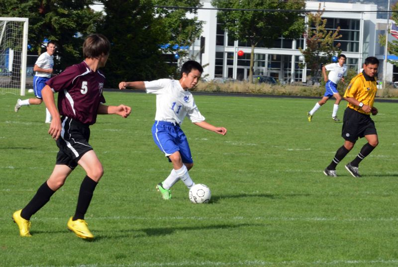 by: TIMES PHOTO: MATT SINGLEDECKER - Valley Catholics Ryosuke Mizuasko dribbles into Daytons side of the pitch in the first half of the Valiants 1-1 tie on Sept. 18.