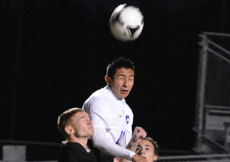 by: TIMES PHOTO: MATT SINGLEDECKER - Sunset senior Josh Lee goes up for header attempt in the first minute of the Apollos 2-0 win over Southridge.