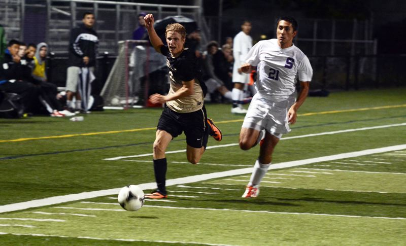 by: TIMES PHOTO: MATT SINGLEDECKER - Southridge forward Matt Kimball runs after a ball in the second half of the Skyhawks 2-0 loss to Sunset.