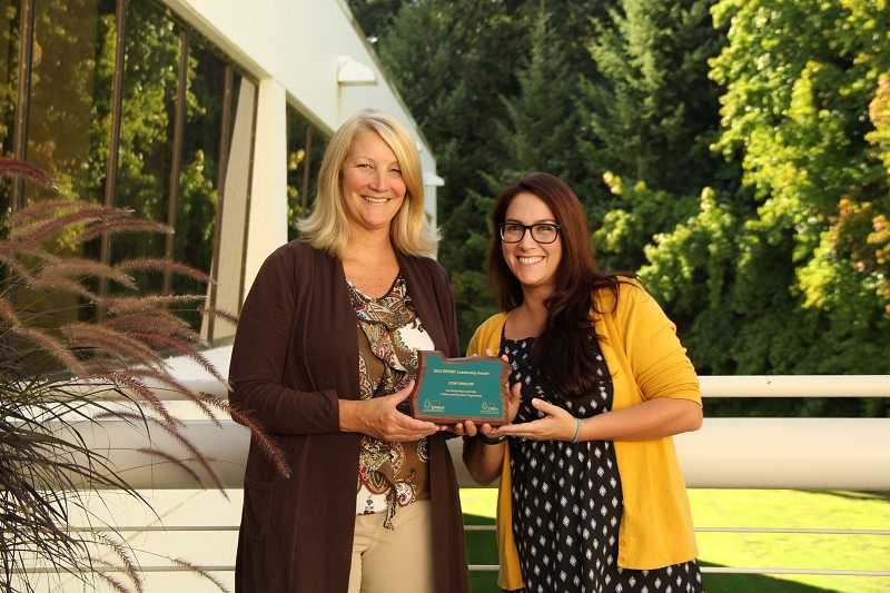 by: SUBMITTED PHOTO - Cydny Fletcher, right, receives her SPRINT award from Jan Wirtz of the Lake Oswego Parks and Recreation Department. Fletcher was recognized for her outstanding leadership of Lake Oswegos youth program.