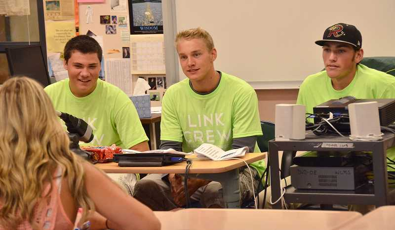 by: TIDINGS PHOTO: VERN UYETAKE - WLHS Link Crew members, from left, Will Strickland, Frederik Larsen and Jordan Dailey meet with their group of incoming freshmen during freshman orientation Sept. 3.