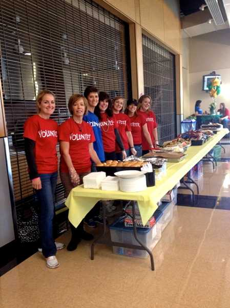 by: SUBMITTED PHOTO - Parent volunteers are ready to serve hungry students and their families at the WLHS back-to-school barbecue on Sept. 20.