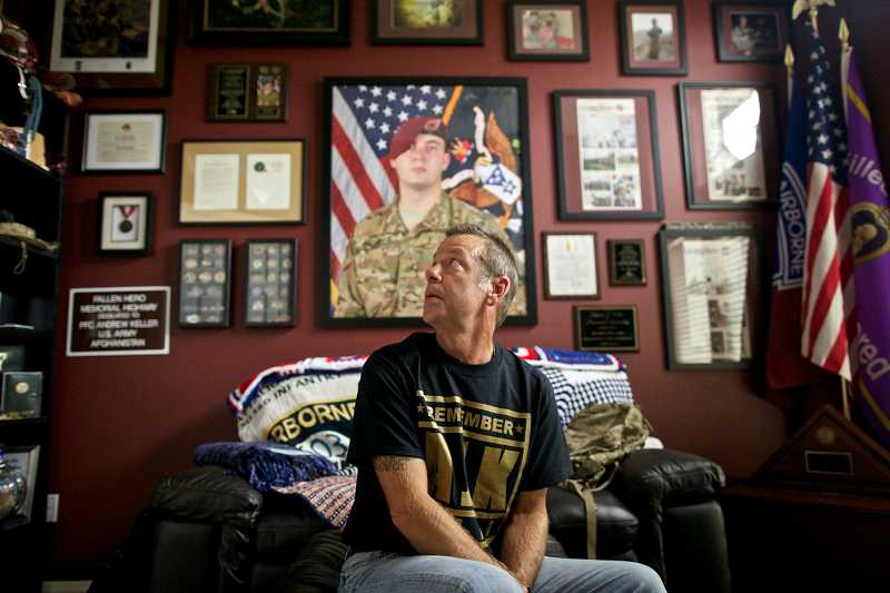 by: TIMES PHOTO: JAIME VALDEZ - Jeff Keller looks around his home office that has been devoted to his oldest son, Andrew, who was killed in Afghanistan. Jeff is wearing a special shirt that will be sold during Friday's Memorial Game at Southridge.