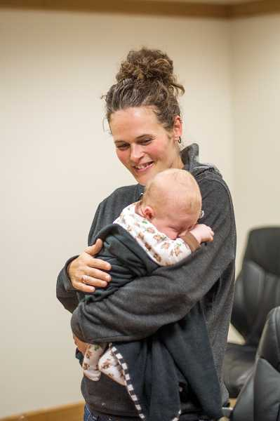 by: TIMES PHOTO: CHASE ALLGOOD - Katlyn Marquess holds her son Thor Hoffman during a reunion to thank the 911 operator and paramedics who helped her during his home birth.