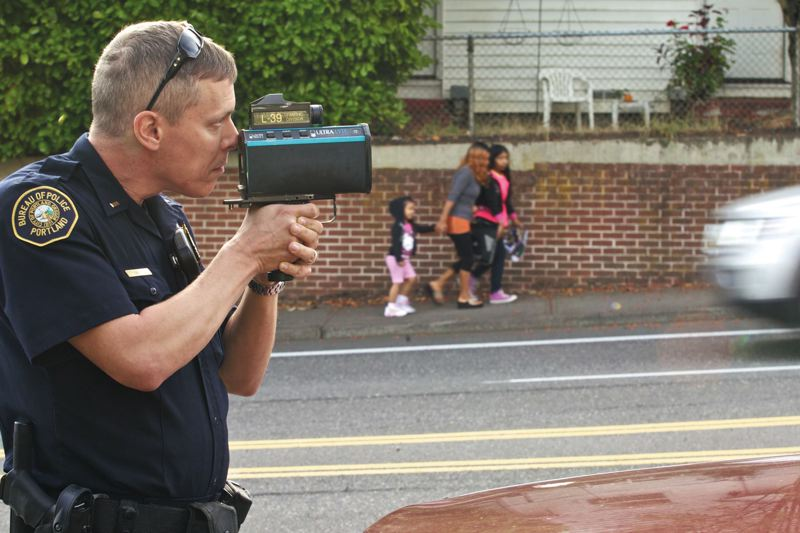by: TRIBUNE PHOTO:  JAIME VALDEZ - Portland Police Lieutenant Chris Davis uses a radar gun to track motorists on Southwest Capitol Highway. Though the number of traffic officers has been reduced, Police Chief Mike Reese says with a larger force he would first devote more officers to gang and domestic violence work, and school patrols.