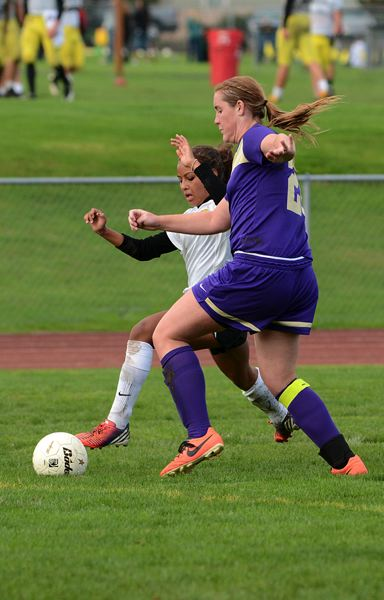 by: JOHN WILLIAM HOWARD - Sophomore Genesis Hansen battles a Bulldog defender for possession. While Hansen didn't score, she made a huge impact by repeatedly winning balls from the opposing team, no matter how bady outmatched.