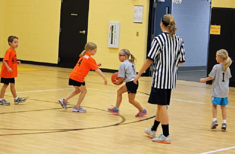 by: SUBMITTED PHOTO - Sign your children up for  Mini Hoopers Basketball or Middle School Basketball programs.