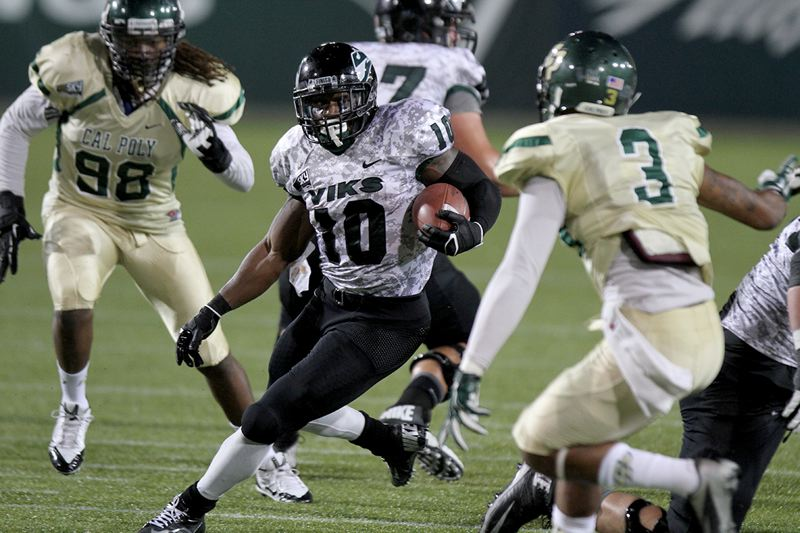 by: TRIBUNE PHOTO: JONATHAN HOUSE - Portland State running back DJ Adams cuts upfield against Cal Poly in the Vikings' Big Sky opener Thursday night at Jeld-Wen Field. PSU led 21-7 at the half before falling 38-34.