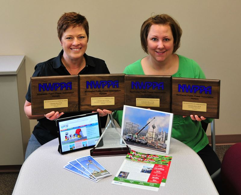 by: SUBMITTED PHOTO - (L to R) Libby Calnon and Nicolle Prehn display awards received Sept. 17 for Columbia River PUD's excellence in communications.